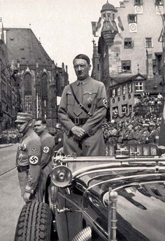 Germany, Hitler in a car awaiting the march of the SA on the Parteitag.