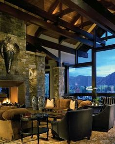 Love the glaas wall, beams and stone fire place.