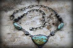 An abundance of love, rich Nevada turquoise buds surrounded with the coolness of rugged antiqued handmade sterling chain. Sweet little sterling and bronze flower buds.