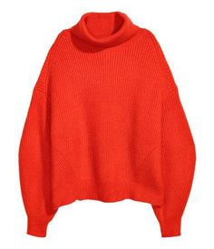 Bright red. Soft, knit sweater with wool content. Ribbed turtleneck, heavily dropped shoulders, and wide sleeves with narrow cuffs.