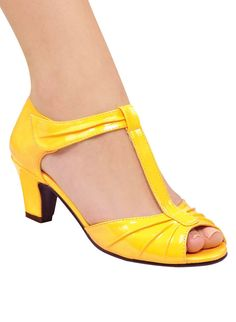 "Stylish, patent peep-toe pump with open shank, T-strap and pleated accents. Magic-cling closure. Cushioned insole and lightweight outsole. 2"" heel. Urethane. Imported. In whole and half sizes. 10, 11, 12 whole sizes only."