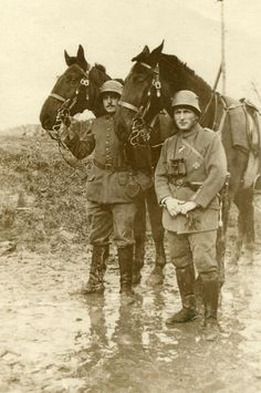 WW1 Dismounted German officer and orderly on a muddy road. -greatwarimages.com