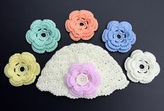 Shell_stitch_baby_cloche... You can change flower by slipping off and on the button..cute idea!!... Free pattern!
