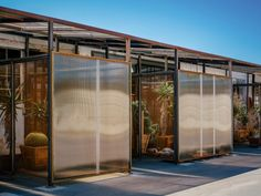 Sliding mesh walls are designed to open up the compartments of this greenhouse for cactuses and large plants, which architecture studio Part Office has added to an industrial-style office building in Santa Monica. Polycarbonate Panels, Urban Nature, Building Facade, Building Ideas, Ponds Backyard, Large Plants, Urban Farming, Dezeen, Art Design