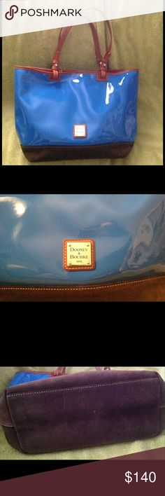 """Dooney & Bourke Patent Leather Purse EUC!!! Gorgeous Royal Blue Patent w/Chocolate Suede bottom colors combine make this this purse pop when added to your wardrobe. Supreme condition, no wear on the outside or inside. No pen marks or scuffs. The red on the inside adds an additional surprise as well. It is a must have!!! Height: 10 1/2"""", Width: 16 1/2"""", Handle Drop: 8 1/2"""". Dooney & Bourke Bags Totes"""