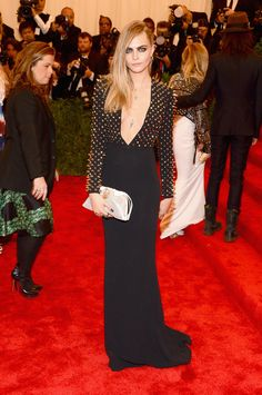 British model Cara Delevingne wearing a studded Burberry column dress to attend the Met Gala in New York