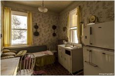 Abandoned kitchen, retro kitchen table etc. We may never know why they left. Recently Freaktography visited this abandoned house in Ontario, Canada, that never experienced any looting (or any disturbance whatsoever). The entire house is basically a time capsule (follow minkshmink on pinterest)