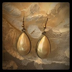 Vintage teardrop earrings These lovelies are made of a molded plastic that resembles mother of pearl. Jewelry Earrings