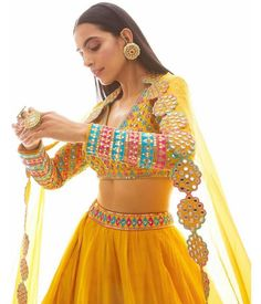 Damn how pretty is this bright yellow outfit!☀️ 'tis surely going to be the most sought after outfit for a day mehndi! Indian Bridal Outfits, Indian Designer Outfits, Pakistani Outfits, Designer Dresses, Indian Attire, Indian Ethnic Wear, Indian Gowns Dresses, Indian Lehenga, Lehenga Dupatta