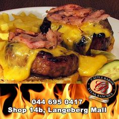 Come out fighting for flavor with the Cattle Baron Mossel Bay's Double fisted Jackson burger. Topped with 2 specially made burger patties, cheese and bacon, with a side of chips, this burger is a knockout. Making Burger Patties, Steak Dishes, Baron, Cattle, Burgers, Jackson, Chips, Beef, Food