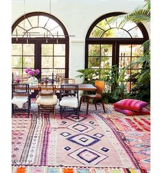 bright colored layered rugs create a graphic and inspiring floor