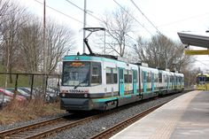 Manchester Metrolink - As a M5000 approaches 1009 is at the back of a double unit departing Abraham Moss.
