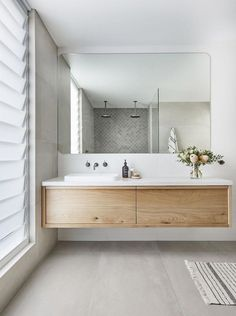 Floating vanity, medium wood tone, while tile and grey fish scale shower tile. Bathroom Trends, Bathroom Renovations, Bathroom Ideas, Bathroom Colors, Remodel Bathroom, Bathroom Organization, Bathroom Pictures, Bathroom Cleaning, Bath Ideas