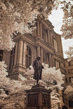 An 8 ft bronze statue stands in front of Boston's Old City Hall on the historic Freedom Trail. The statue has stood there since 1856. Just to the left of this area is an older area known as King's Chapel Burying Ground.