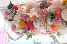 Pom poms and flowers! by Lucy from Peas and Needles                                                                                                                                                                                 More