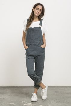The RVCA Decklin Denim Overall is a loose fit denim overall with a straight leg and an ankle fit. It has adjustable straps, front and back pockets, and ...