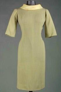 Marilyn's John Moore dress with boat neck in a beige knit.