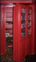 Bookshelves in a door reveal a secret closet. I've always loved hidden passageways and secret rooms. Red Bookcase, Bookshelf Door, Hidden Spaces, Hidden Rooms, Secret Space, Secret Rooms, Secret Storage, Hidden Storage, Hidden Passages