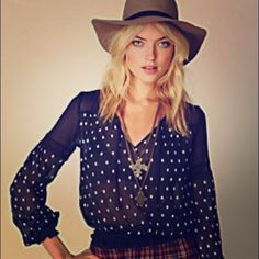 Free People Polka Dot Crinkle Top Look Parisian chic in this polka dot blouse!  Detail: Sheer, V-Neck With Tie, Ruched Elastic Waist Band And Cuffs, Lace Paneling On Sleeves. Free People Tops