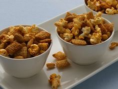 Parmesan, peanuts and popcorn create a fiesta of flavor in a savory cereal snack mix.