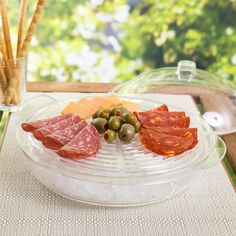 Keep your fruit, veggies, meat and cheese fresh and cool at the cottage or at your next backyard barbeque! Our Chill It Serving Platter features 3 deep compartments that can be used for serving or as ice compartments below the secure-fit ridged serving platter.  Clear BPA-free plastic chamber with domed lid helps keep your food fresh and cool and prevents outdoor pests from getting at your favourite snacks!