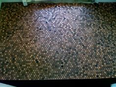 """We just installed the pennies (we had glued to the mosaic tile mesh backing) directly over the existing ceramic tile in the vestibule (foyer/entryway) with regular thin set. We then grouted it with laticrete epoxy grout in chocolate truffle.  It was really very easy and i love the way it came out.. most people that first see it don't realize that it's pennies. It took 3,889 pennies (it's about 3'-8"""" x 5'-8"""")...so $38.89 for app. 24 sf of tile is not bad at all."""