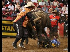Frank Newsom goes in for the save as Stormy Wing struggles to get his feet. Photo by Andy Watson / BullStockMedia.com.