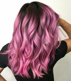 Pretty pink curly hair.
