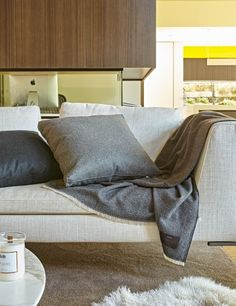 ARIA Incredibly soft, pure Italian cashmere throws are extremely lightweight yet exceptionally warm.  https://www.abodeliving.com/bedroom/blankets-throws/ariacashmere.html