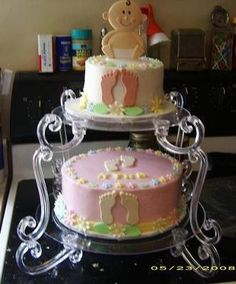 Baby Shower Footprint Cake: This Baby Shower Footprint Cake was a 10 - 2 layer and a 8 2 layer yellow cake.   The bottom was frosted in pink butter cream and the top in white butter