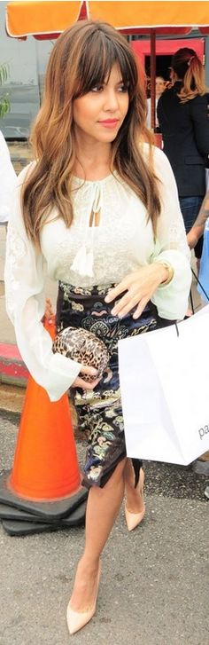 Kourtney Kardashian: Shirt – Gold Hawk  Purse – Kardashian Kollection  Bracelet/watch – Bvlgari  Shoes – Gianvito Rossi
