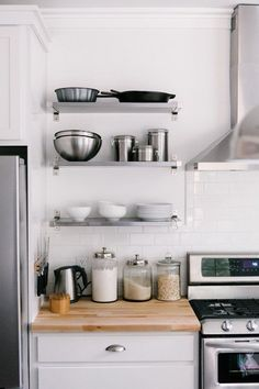 white-kitchen-stainless-steel-shelves
