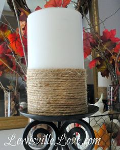 Jute-Wrapped Candle Tutorial... Simply wrap twine around pillar candles. Tuck the ends in to secure (no hot glue needed).