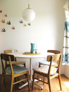 Cut shapes out of pretty paper, possibilities are endless: birds, flowers, butterflies...