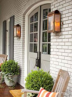 Play up the angles to create memorable monochromatic facades. Look closely and you'll see what BHG readers appreciated about this entry porch. Light taupe horizontal bricks contrast with arched doors painted a medium taupe, while vertical shutters present the palette's deepest tone in an impactful manner.
