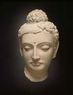 Head of Buddha Śākyamuni, 4th century. Afghanistan, ancient Gandhāra region, probably Hadda. Stucco with traces of pigment.