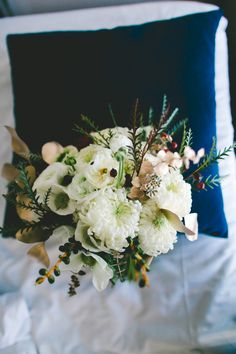 ivory bouquet with green and gold accents, photo by Bethany Carlson http://ruffledblog.com/loft-san-diego-wedding #flowers #goldwedding #eucalyptus