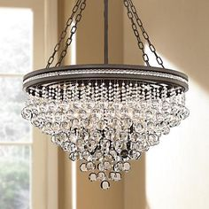 Sparkling pendant light featuring crystal droplets and a sage finish.