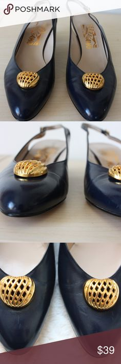 Salvatore Ferragamo Vintage Navy Slingback Pumps Salvatore Ferragamo Vintage Slingback Pumps Women's size 7.5 AA (Narrow). Measurements are approximately 9.25'' long and 3'' across at the widest part of the ball of the foot Navy leather uppers with gold metal adornment on top Ferragamo signature engraved buckles Gorgeous condition for a vintage pair. One small stain on inside of right strap not visible when worn, very minor scuffing on soles. Salvatore Ferragamo Shoes Heels