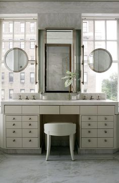 BATHROOM David Kleinberg | Round mirrors in front of windows - this is a genius way to be functional & pretty.