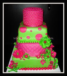 "Hot Pink and green Wedding Cake - 16""/14""/9""/6"" decorated with mm fondant. I really like this"