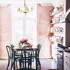 pink accent wall in the kitchen