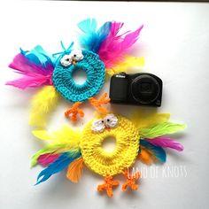 A personal favorite from my Etsy shop https://www.etsy.com/listing/290953495/bird-camera-lens-buddy-crochet-camera