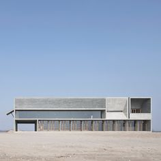Vector Architects completes a seaside library with board-marked concrete walls