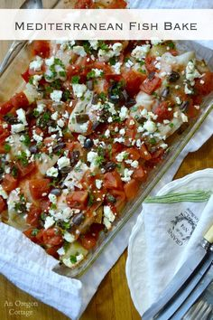 Mediterranean Fish Bake - a one-dish meal bursting with flavor from feta cheese, kalamata olives and garlic. You'll want to serve it with a good bread to sop up all the juices!