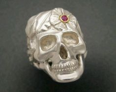 silver skull ring with ruby & gold detailing