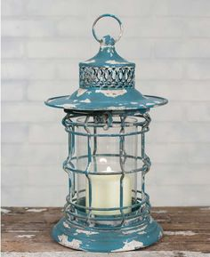 """8"""" dia. x 13""""T. A glass chimney is included. Lantern latches at the top for easy access. Shown with a 3"""" pillar candle, not included."""