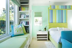 An analogous color scheme in a clean lined room. Would be great for a teen. Has good storage & a contemporary take on a canopy/ tented bed.