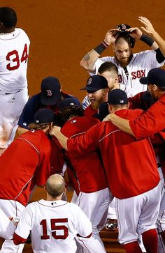 BOSTON, MA - AUGUST 1: Stephen Drew #7 of the Boston Red Sox is mobbed by his teammates following the game-winning hit in the bottom of the 15th inning against the Seattle Mariners to score Dustin Pedroia #15 of the Boston Red Sox during the game on August 1, 2013 at Fenway Park in Boston, Massachusetts. (Photo by Jared Wickerham/Getty Images)