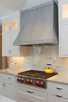 Range hood + marble backsplash = kitchen love